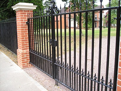 Installing metal gates within metal railings