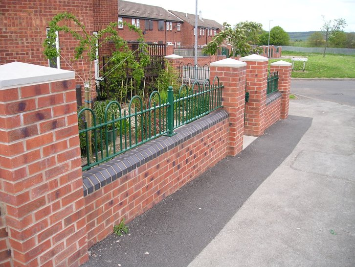 decorative bow top railings galv and powder coated into stone copings