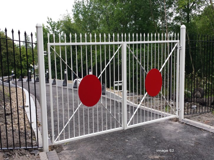Vertical bar style gates with plate and cross members to resemble level crossing