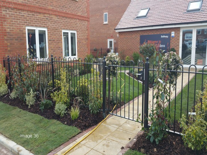 How metal railings differentiate a housing development marketing suiteed bow top railings