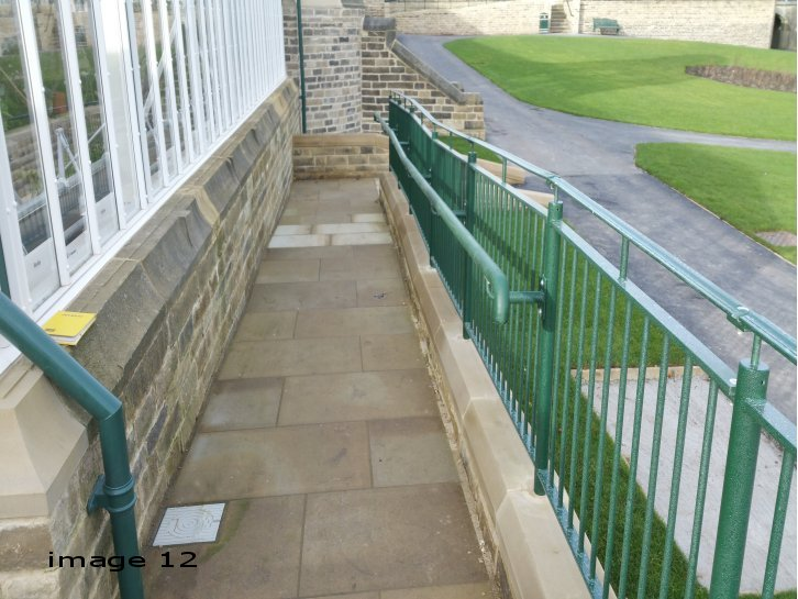 galvanized and powder coated balustrade along ramp c/w handrail