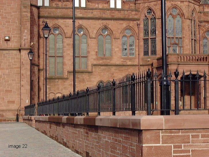 Black powder coated metal railings with fiinial