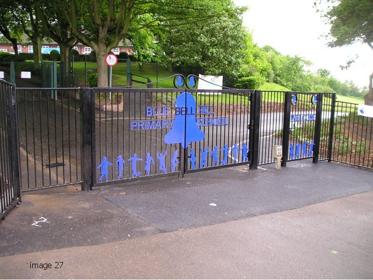 Decorative flat top gate with laser profiled figures