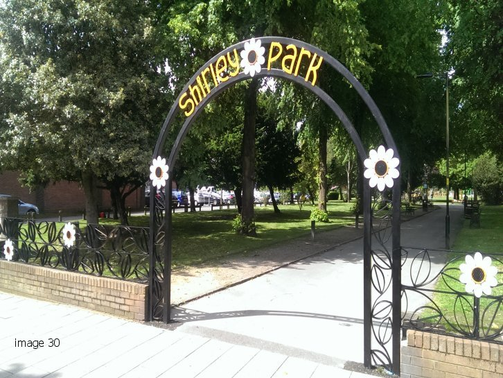 Galvanised and powder coated decorative arch with laser profiled flowers
