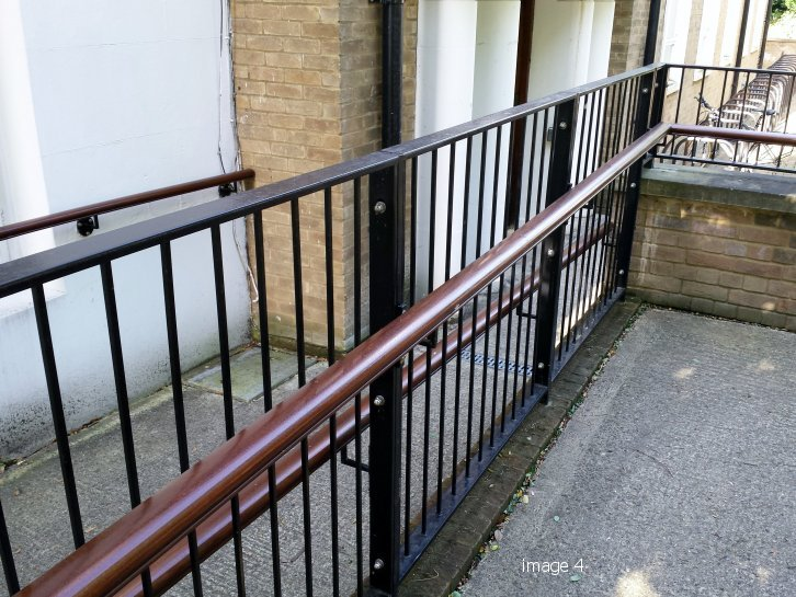 Handrail attached to flat top railings