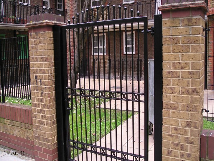 Decorative arched top gate with sphere finials