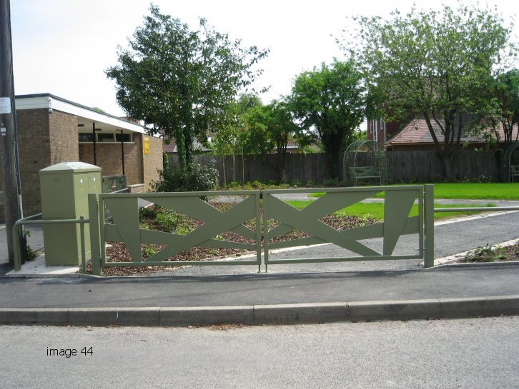 galvanized and powder coated 'search light feature' double leaf gate
