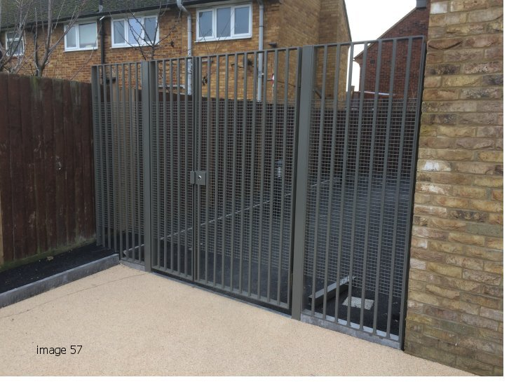 vertical bar gate with weldmesh attached