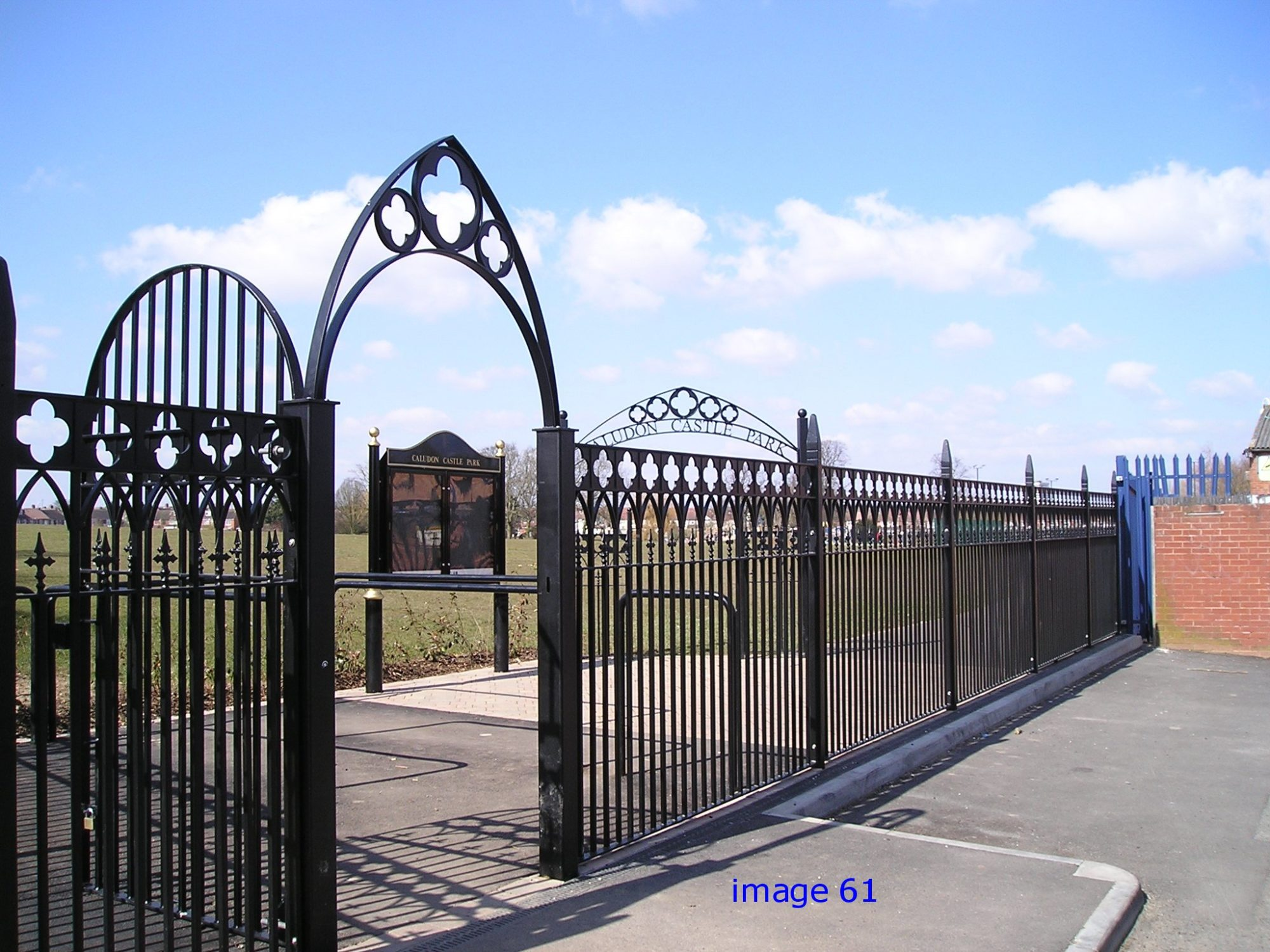 Decorative flat top railings and arched top gat