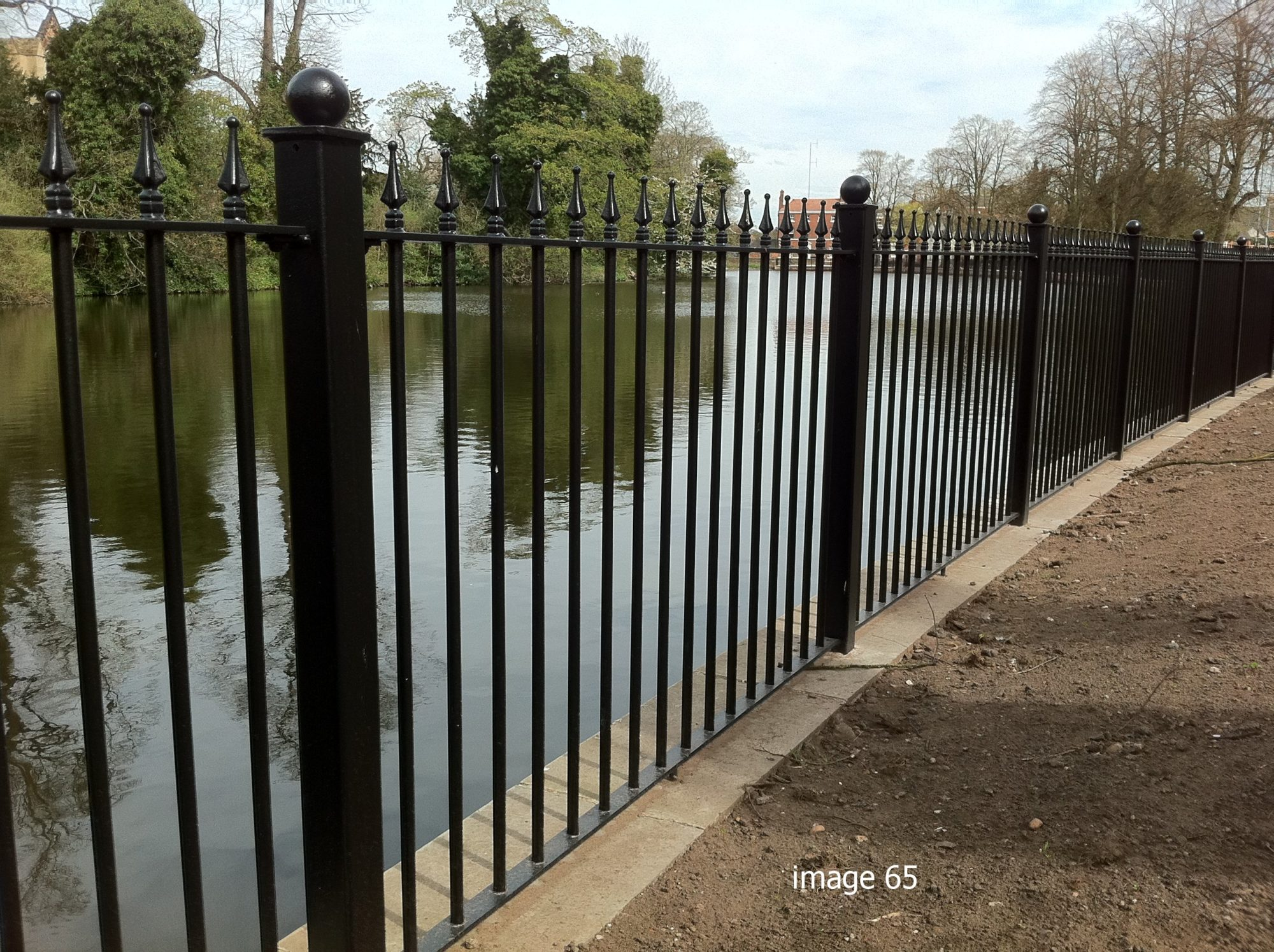 Decorative vertical bar railings by the riverside