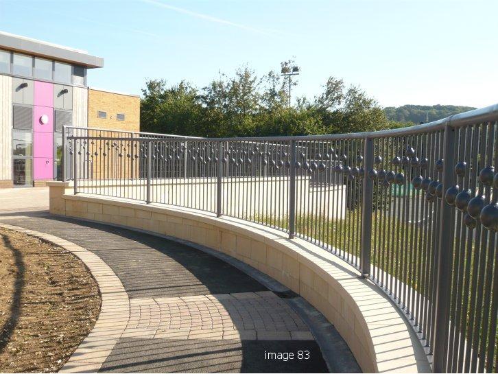 Radiused bespoke metal railings with sphere detail