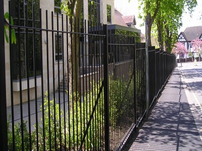 galvanized and powder coated mild steel vertical bar railings and sliding gates to BS 1722 Part 9.