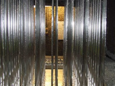 galvanized vertical bar panels after removal from galvanizing process