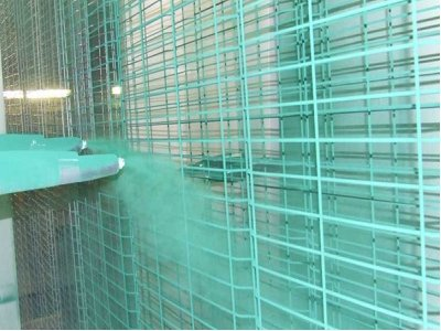 galvanized twin wire mesh fencing in the process of being polyester powder coated.