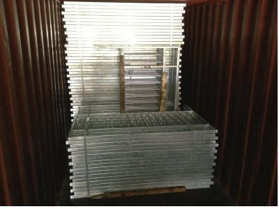 galvanized pedestrian guardrail inside container awaiting shipment to Nigeria