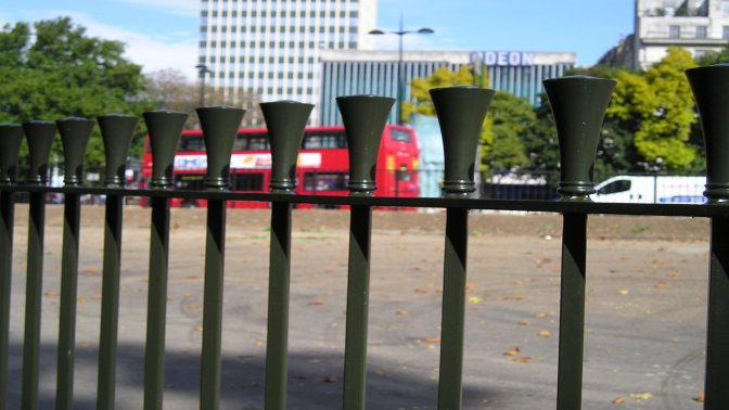 vertical bar railings with 'megaphone' finial