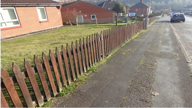 wooden fencing surrounding residential properties