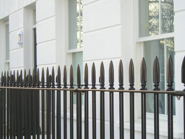 Galvanised and powder coated vertical bar railings with decorative finials