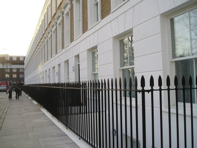 galvanized and powder coated vertical bar railings featuring spear head finial