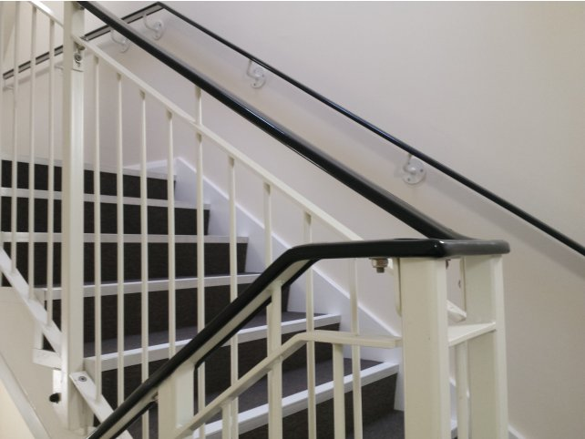Mild steel handrail for internal stair core