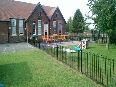 galvanized and powder coated mild steel Playspec@ Bow Top Railings to primary school