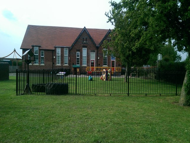galvanized and powder coated mild steel Playspec Bow Top Railings to primary school