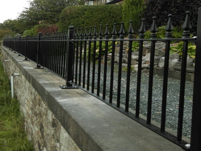 decorative vertical bar railings to front of properties