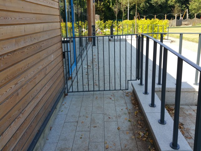 mild steel bow top railings galvanized and powder coated green