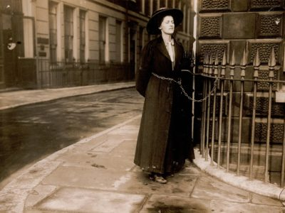 Suffragette chained to metal railings