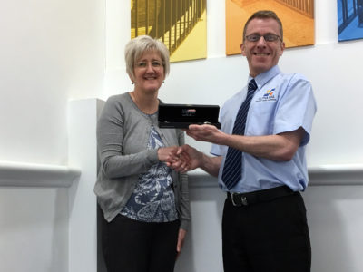 Finance Director Mark Sipson presents Yvonne with new bracelet to celebrate 20th anniversary