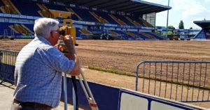 Roger Bristol surveying a site