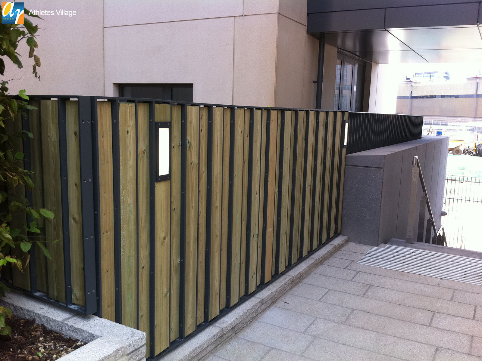 Athletes Village flat bar infill metal railings
